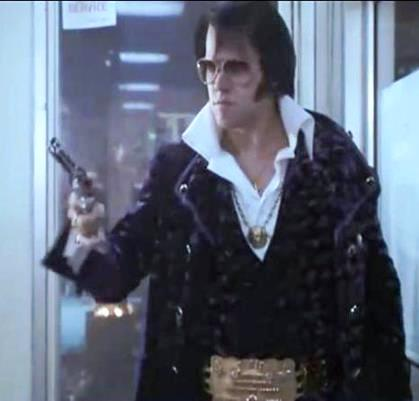 Elvis Pulling Gun in Doughnut Shop - Elvis Meets Nixon