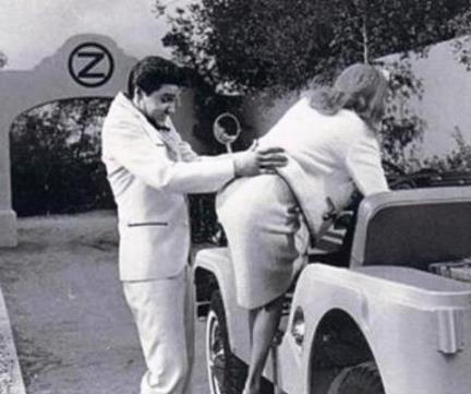 Elvis Helping a Woman Get in Jeep