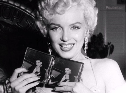 Marilyn Holding Elvis Photographs