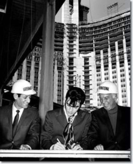 Elvis and Kirk Kerkorian Signing Contract at International Hotel