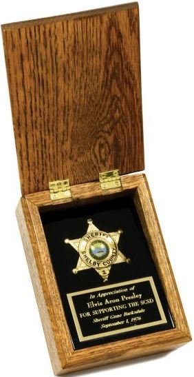 Elvis' Shelby County Sheriff's Badge in Case