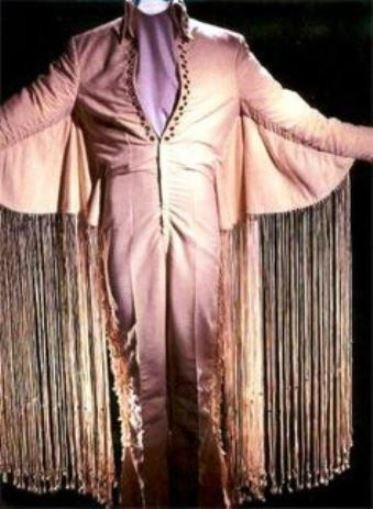 Long White Fringe Suit...Elvis only wore one time. The fringe got all tangled up when he danced.