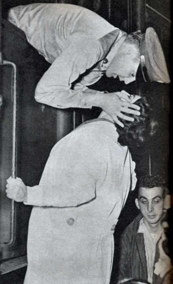 Elvis on train to NY to embark on the SS Randall for Germany. The train stopped briefly in Memphis which is why George Klein is in the picture. Elvis is kissing a fan