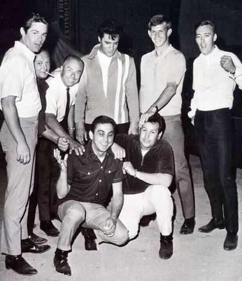 set of Speedway- Standing – Jerry Schilling, Marty Lacker, Larry Jost (sound department), Elvis, Don Sutton, and Richard Davis. Kneeling – George Klein and Joe Esposito