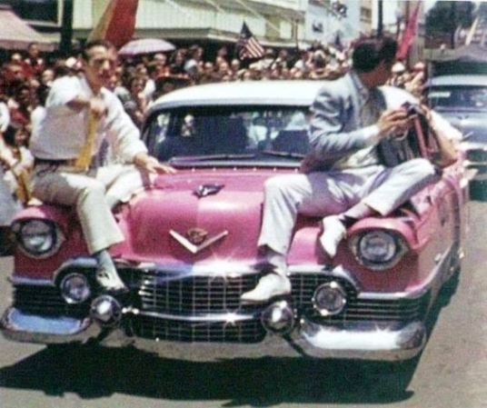 May 26, 1955 - Elvis Presley with Jimmie Rodgers Snow on Elvis´ pink Cadillac Fleetwood in Meridian, Mississippi - Jimmie Rodgers Festival parade....