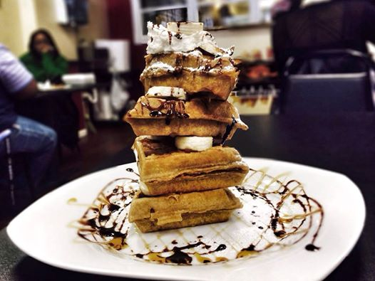 The Elvis Waffles with peanut butter, bananas, candied bacon, chocolate and caramel sauce Superchefs in downtown Columbus 9.99.