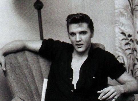 Elvis with Short Sleeves Rolled up, Buttons Open, Collar Up