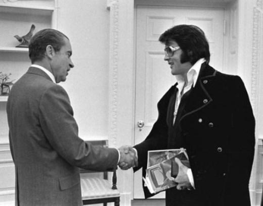 Elvis Presley shakes hands with President Nixon