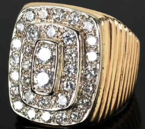 Elvis Pesley's Three-Tiered Diamond Ring with E.P. Engraved on Interior of the Band